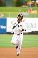 Luis Jimenez (7) of the Salt Lake Bees rounds the bases after hitting a home run against the Tacoma Rainiers in Pacific Coast League action at Smith's Ballpark on July 9, 2014 in Salt Lake City, Utah.  (Stephen Smith/Four Seam Images)