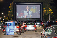 """Democratic nominee for Vice President Kamala Harris is seen on a screen as people gathered to watch the 2020 Democratic National Convention at a """"Ridin' with Biden"""" Drive-In Theater viewing event at Suffolk Downs in Boston, Massachusetts, on Wed., Aug. 19, 2020."""