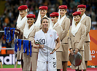 Abby Wambach (20) of the United States stands with her individual  trophy during the final of the FIFA Women's World Cup at FIFA Women's World Cup Stadium in Frankfurt Germany.  Japan won the FIFA Women's World Cup on penalty kicks after tying the United States, 2-2, in extra time.