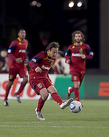 Real Salt Lake midfielder Ned Grabavoy (20) passes the ball. In a Major League Soccer (MLS) match, Real Salt Lake defeated the New England Revolution, 2-0, at Gillette Stadium on April 9, 2011.