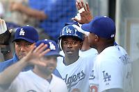 Los Angeles Dodgers shortstop Dee Gordon #9 greets teammates after scoring against the Cincinnati Reds at Dodger Stadium on June 14, 2011 in Los Angeles,California. (Larry Goren/Four Seam Images)