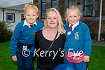 Dariah Zytka on her first day in Junior Infants at Scoil Eoin Balloonagh on Wednesday with her brother and mother Julian Zytka and Eva Gorham.