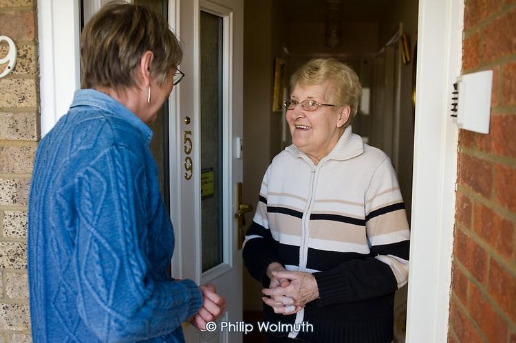 An Age UK Norfolk Money Matters volunteer adviser with an elderly client, Sprowston, Norwich.