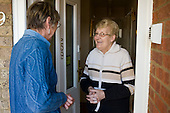 An Age UK Norfolk Money Matters volunteer adviser with an elderly client, Sprowston, Norwich.