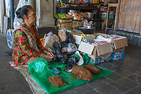 Yogyakarta, Java, Indonesia.  Woman Selling Tobacco, Beringharjo Market.
