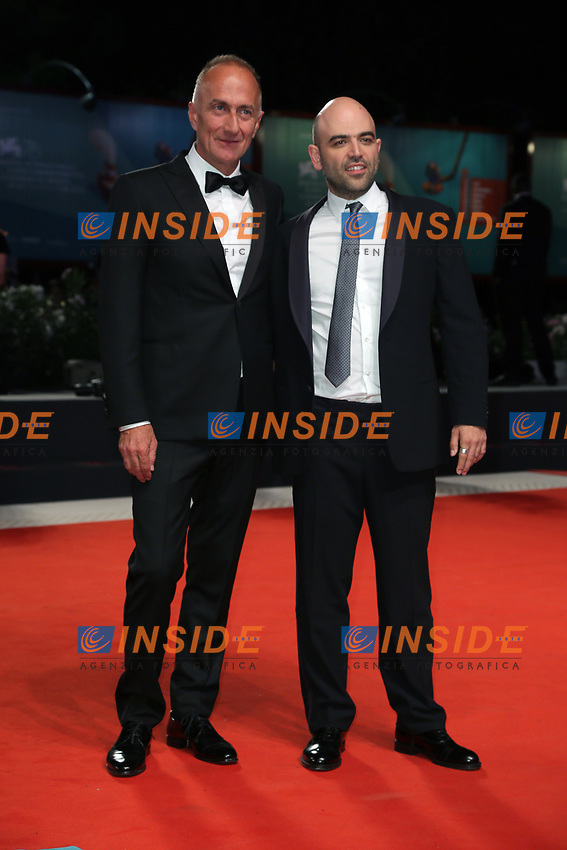 "VENICE, ITALY - SEPTEMBER 05: Stefano Sollima and Roberto Saviano walk the red carpet of the ""ZeroZeroZero"" screening during the 76th Venice Film Festival at Sala Grande on September 05, 2019 in Venice, Italy. (Photo by Mark Cape/Insidefoto)<br /> Venezia 05/09/2019"