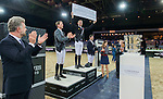 Marco Kutscher riding Van Gogh, Kevin Staut riding For Joy van't Zorgvliet HDC and Emanuele Gaudiano riding Caspar 232 celebrate at the podium after Kutscher,s victory  at the Longines Grand Prix, part of the Longines Masters of Hong Kong on 21 February 2016 at the Asia World Expo in Hong Kong, China. Photo by Li Man Yuen / Power Sport Images