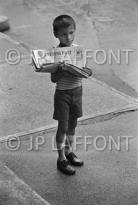 Boy selling newspaers on the streets of Manilla, Philippines - Child labor as seen around the world between 1979 and 1980 – Photographer Jean Pierre Laffont, touched by the suffering of child workers, chronicled their plight in 12 countries over the course of one year.  Laffont was awarded The World Press Award and Madeline Ross Award among many others for his work.