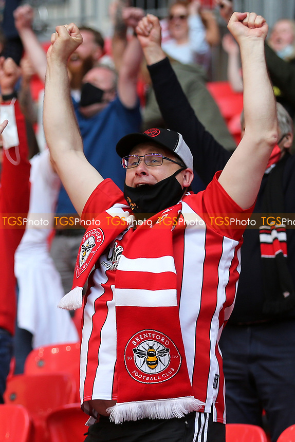 A Brentford fan celebrates their victory and promotion to the Premier League during Brentford vs Swansea City, Sky Bet EFL Championship Play-Off Final Football at Wembley Stadium on 29th May 2021