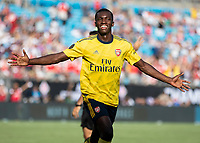 CHARLOTTE, NC - JULY 20: Eddie Nketiah #30 celebrates his goal during a game between ACF Fiorentina and Arsenal at Bank of America Stadium on July 20, 2019 in Charlotte, North Carolina.