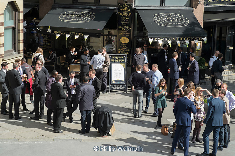 City of London workers take a lunchtime drink outside a pub