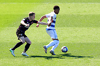 24th April 2021; The Kiyan Prince Foundation Stadium, London, England; English Football League Championship Football, Queen Park Rangers versus Norwich; Chris Willock of Queens Park Rangers is under pressure from Oliver Skipp of Norwich City