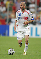 French captain (10) Zinedine Zidane looks for an open teammate.  France defeated Portugal, 1-0, in their FIFA World Cup semifinal match at FIFA World Cup Stadium in Munich, Germany, July 5, 2006.