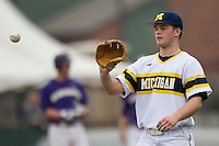 Michigan Wolverines pitcher Brett Adcock (35) during the NCAA baseball game against the Washington Huskies on February 16, 2014 at Bobcat Ballpark in San Marcos, Texas. The game went eight innings, before travel curfew ended the contest in a 7-7 tie. (Andrew Woolley/Four Seam Images)