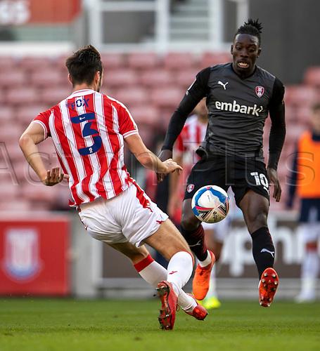 31st October 2020; Bet365 Stadium, Stoke, Staffordshire, England; English Football League Championship Football, Stoke City versus Rotherham United; Freddie Ladapo of Rotherham United and Morgan Fox of Stoke City look for the lose ball