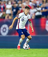 NASHVILLE, TN - SEPTEMBER 5: Christian Pulisic #10 of the United States dribbles during a game between Canada and USMNT at Nissan Stadium on September 5, 2021 in Nashville, Tennessee.