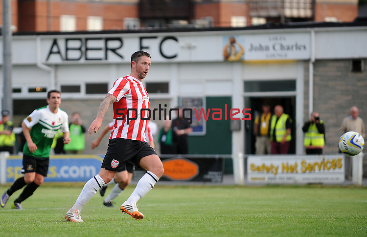 10 July 2014; Rory Patterson, Derry City, scores a penalty and gets his hatrick Aberystwyth Town. UEFA Europa League First Qualifying Round, Second Leg, Aberystwyth Town v Derry City. Park Avenue, Aberystwth, Wales. Picture credit: Ian Cook / SPORTINGWALES