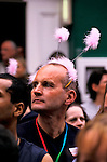 'GAYFEST MANCHESTER, UK', A MAN WITH SOFT PINK 'FEELERS' WATCHES THE PARADE THROUGH MANCHESTER, 1999