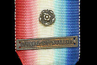 BNPS.co.uk (01202 558833)<br /> Pic: DixNoonanWebb/BNPS<br /> <br /> Pictured: A dated badge on the medal.<br /> <br /> A school has missed out in its bid to buy the medal of the first British soldier killed in World War One after it sold for a whooping £17,000.<br /> <br /> Private John Parr, was shot dead by a German patrol near Mons in Belgium on August 21, 1914.<br /> <br /> The 17-year-old had been deployed in a two-man team as a reconnaissance cyclist to scout out German positions.<br /> <br /> The pair were spotted by the German First Army and a firefight ensued, with Pte Parr heroically sacrificing himself so his comrade could escape unscathed and report back to the British lines.