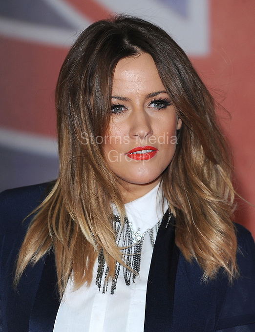 LONDON, ENGLAND - FEBRUARY 21:  Caroline Flack arrives at the BRIT Awards 2012 at O2 Arena on February 21, 2012 in London, England.  <br /> <br /> People:    Caroline Flack