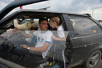 A family in their car filling expatriation documents waiting inline at the border between Ukraine and Russia at Izvarine check point - one of border crossings controlled by Luhansk Peoples Republic. According to rebels around 5 thousand people leave Ukraine every day through Izvarine border crossing. June 27, 2014