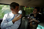 Allentown, Pennsylvania.USA.September 10, 2004..Democratic Presidential hopeful Senator John Kerry with his press secretary Stephanie Cutter and aid Setti in his SUV driving from the airport to the rally site.