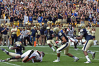 Pitt safety Jarred Holley (18) returns an interception. The Pitt Panthers defeated the Virginia Tech Hokies 35-17 at Heinz field in Pittsburgh, PA on September 15, 2012.