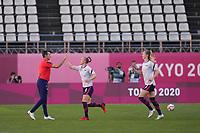 KASHIMA, JAPAN - AUGUST 4: Head Coach Vlatko Andonovski of the United States greets Becky Sauerbrunn #4 of the United States before a game between Australia and USWNT at Kashima Soccer Stadium on August 4, 2021 in Kashima, Japan.