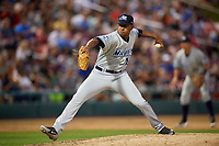 West Michigan Whitecaps relief pitcher Felix Viloria (12) delivers a pitch during a game against the Kane County Cougars on July 19, 2018 at Northwestern Medicine Field in Geneva, Illinois.  Kane County defeated West Michigan 8-5.  (Mike Janes/Four Seam Images)