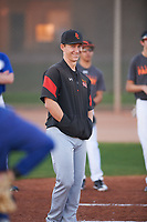 An assistant coach for the Giants during the Under Armour Baseball Factory Recruiting Classic at Gene Autry Park on December 27, 2017 in Mesa, Arizona. (Zachary Lucy/Four Seam Images)