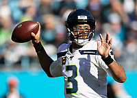 CHARLOTTE, NC - DECEMBER 15: Russell Wilson #3 of the Seattle Seahawks passes the ball during a game between Seattle Seahawks and Carolina Panthers at Bank of America Stadium on December 15, 2019 in Charlotte, North Carolina.