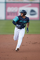 Yainer Diaz (8) of the Lynchburg Hillcats hustles towards third base against the Myrtle Beach Pelicans at Bank of the James Stadium on May 22, 2021 in Lynchburg, Virginia. (Brian Westerholt/Four Seam Images)