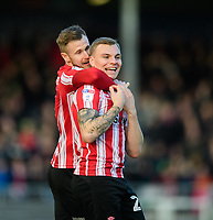 Lincoln City's Harry Anderson, right`, celebrates scoring his side's second goal with team-mate Michael O'Connor<br /> <br /> Photographer Chris Vaughan/CameraSport<br /> <br /> The EFL Sky Bet League Two - Lincoln City v Newport County - Saturday 22nd December 201 - Sincil Bank - Lincoln<br /> <br /> World Copyright © 2018 CameraSport. All rights reserved. 43 Linden Ave. Countesthorpe. Leicester. England. LE8 5PG - Tel: +44 (0) 116 277 4147 - admin@camerasport.com - www.camerasport.com