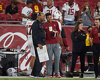 LOS ANGELES, CA - SEPTEMBER 11: Head coach David Shaw of the Stanford Cardinal talks to his son Carter Shaw during a game between University of Southern California and Stanford Football at Los Angeles Memorial Coliseum on September 11, 2021 in Los Angeles, California.