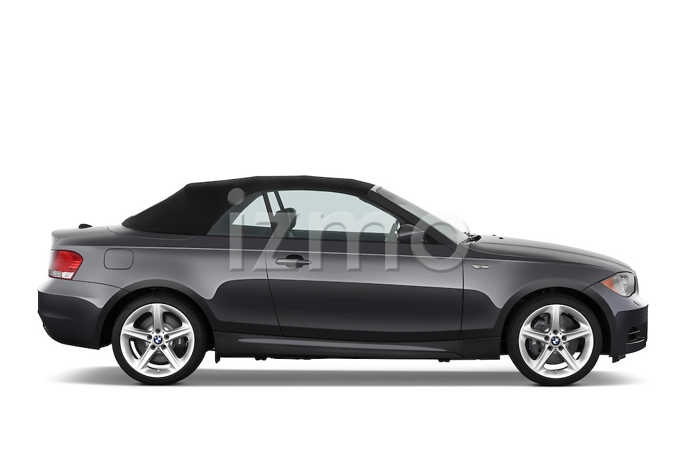 Passenger side profile view of a 2007 - 2011 BMW 1-Series 135i convertible.