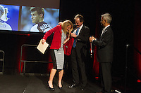 San Francisco, CA - Saturday Feb. 14, 2015: US Soccer player Kristine Lilly receives her US Soccer Hall of Fame jacket from Anson Dorrance and US Soccer president Sunil Gulati at the 2014 US Soccer Hall of Fame Induction ceremony.