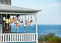 Decorative buoys on waterfront porch, York, Maine