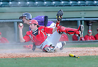 Catcher John Crummy (27) of the Miami (Ohio) Redhawks holds up the ball and waits for the out call following a collision with Paul Nitto (18) of the Furman Paladins on Sunday, February 17, 2013, at Fluor Field at the West End in Greenville, South Carolina. Crummy held onto the ball and made the out. Furman won, 6-5. (Tom Priddy/Four Seam Images)