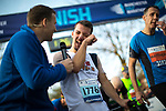 © Joel Goodman - 07973 332324. 15/10/2017 . Manchester , UK . Athlete PATRICK BARDEN from Kent , who has Cerebral Palsy , reaches the finish line having raced over three days , in the Greater Manchester Half Marathon in Old Trafford . Photo credit : Joel Goodman
