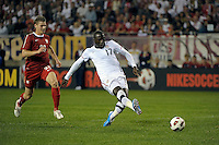 US forward Jozy Altidore (17) shoots the ball in front of Poland defender Lukasz Piszczek (26) to score the first US goal.  The U.S. Men's National Team tied Poland 2-2 at Soldier Field in Chicago, IL on October 9, 2010.
