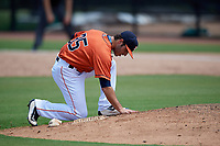 GCL Astros relief pitcher Joey Gonzalez (35) smoothes out the dirt on the back of the mound during a game against the GCL Nationals on August 6, 2018 at FITTEAM Ballpark of the Palm Beaches in West Palm Beach, Florida.  GCL Astros defeated GCL Nationals 3-0.  (Mike Janes/Four Seam Images)