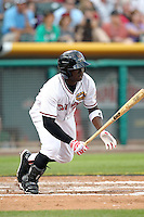 Trayvon Robinson #21 of the Albuquerque Isotopes plays for the Pacific Coast League All-Stars in the annual Triple-A All-Star Game against the International League All-Stars at Spring Mobile Ballpark on July 13, 2011  in Salt Lake City, Utah. The International League won the game, 3-0. Bill Mitchell/Four Seam Images.