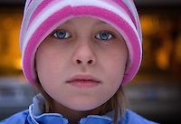 Young girl with blue eyes stares at camera<br />