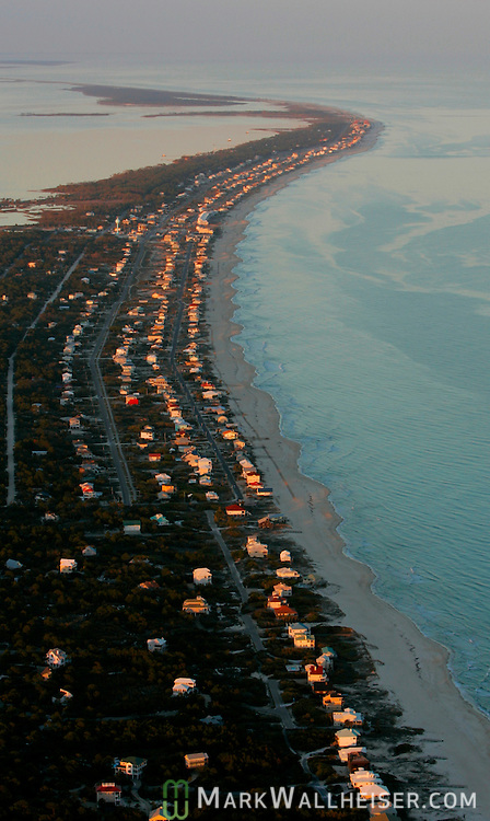 The sun set reflects off the vacation homes at dusk on St George Island along the Forgotten Coast in Franklin County southwest of Tallahassee, Florida.    (Mark Wallheiser/TallahasseeStock.com)