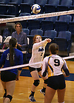 Marymount's Cassidie Watson passes in a college volleyball game in Lexington Park, MD, on Wednesday, Oct. 29, 2014. Marymount won 3-2 to go 24-9 on the season.<br /> Photo by Cathleen Allison