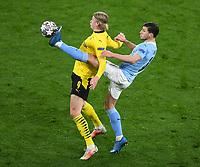 14th April 2021; Induna Park, Dortmund, Germany; UEFA Champions League Football quarter-final, Borussia Dortmund versus Manchester City; Erling Haaland BvB fued from behind by Ruben Dias City