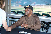 Baseball Hall of Famer Andre Dawson shakes the hand of a fan as he signs autographs prior to the International League game between the Toledo Mud Hens and the Charlotte Knights at BB&T BallPark on April 24, 2019 in Charlotte, North Carolina. The Knights defeated the Mud Hens 9-6. (Brian Westerholt/Four Seam Images)