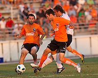 Chad Smith and Chris Klotz of the Charlotte Eagles converge on Johan Elmander during a game against the Bolton Wanderers.  Elamander successfully evaded Smith and Klotz to score the Wanderers second goal.   The Charlotte Eagles currently in 3rd place in the USL second division play a friendly against the Bolton Wanderers from the English Premier League.