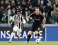 Football Soccer: UEFA Champions League Juventus vs Tottenahm Hotspurs FC Round of 16 1st leg, Allianz Stadium. Turin, Italy, February 13, 2018. <br /> Tottenham's Harry Kane (r) in action with Juventu's Douglas Costa (l) during the Uefa Champions League football soccer match between Juventus and Tottenahm Hotspurs FC at Allianz Stadium in Turin, February 13, 2018.<br /> UPDATE IMAGES PRESS/Isabella Bonotto