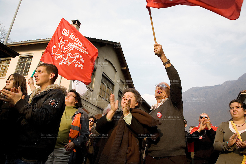 """Switzerland. Canton Ticino. Bellinzona. Town center. Massive demonstration ( estimation of 8000 people) to denounce the ultimatum from SBB CFF FFS and to support the SBB CFF FFS Cargo railway workers on strike and the committee"""" Giù le mani dall'Officina di Bellinzona"""" . 30.03.08. © 2008 Didier Ruef"""